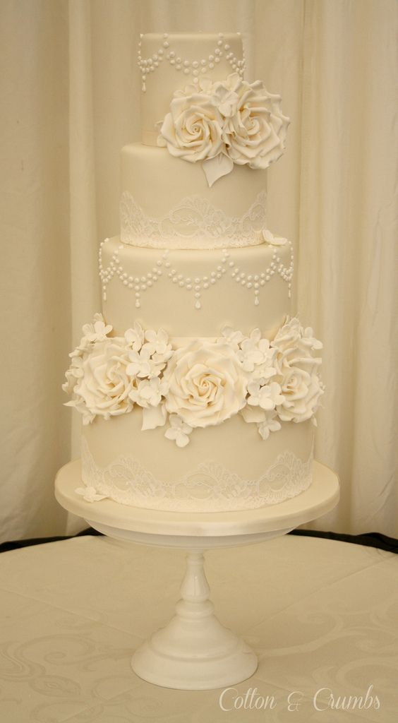 All ivory cake with ivory roses, hydrangeas and calla lillies x