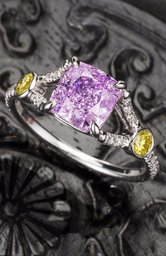 An extremely rare fancy coloured diamond and diamond ring The cushion-shaped fancy intense pinkish purple diamond, weighing 1.51 carats, between bifurcated shoulders set with brilliant-cut diamonds, accented by similarly cut diamonds of yellow tint