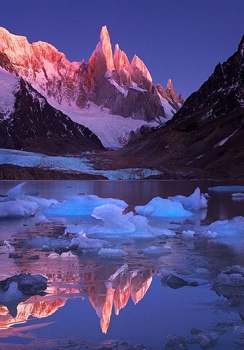 Crimson Crags, Cerro Torre, Patagonia by Michael Anderson: Named after Captain Robert FitzRoy of the HMS Beagle who charted much of coastal Patagonia in the 1830's, the mountain has a reputation of being ultimate, not because of its average height., but because of its sheer granite faces. (The logo for Patagonia, Inc is the skyline of Mount Fitz Roy looking west.) http://en.wikipedia.org/wiki/Fitz_Roy #Patagonia #Mount_Fitz_Roy