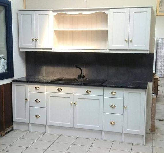 Absolutely gorgeous hand made and painted solid pine kitchen with marble worktop and metal handles.