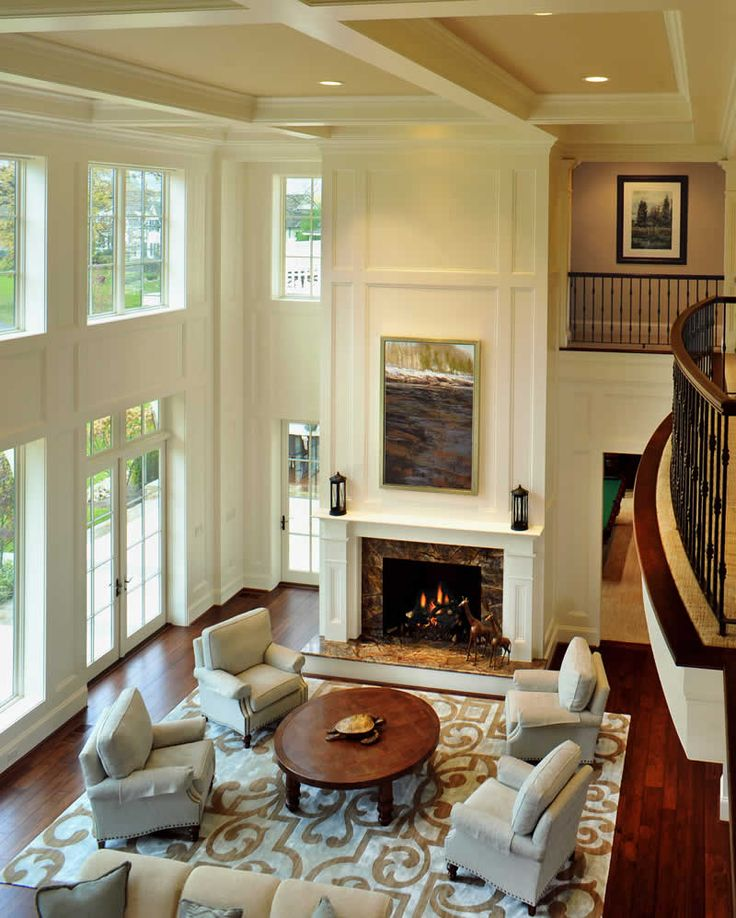 Living Room With Fireplace And Windows breaking up a two story wall | two-story family room | pinterest