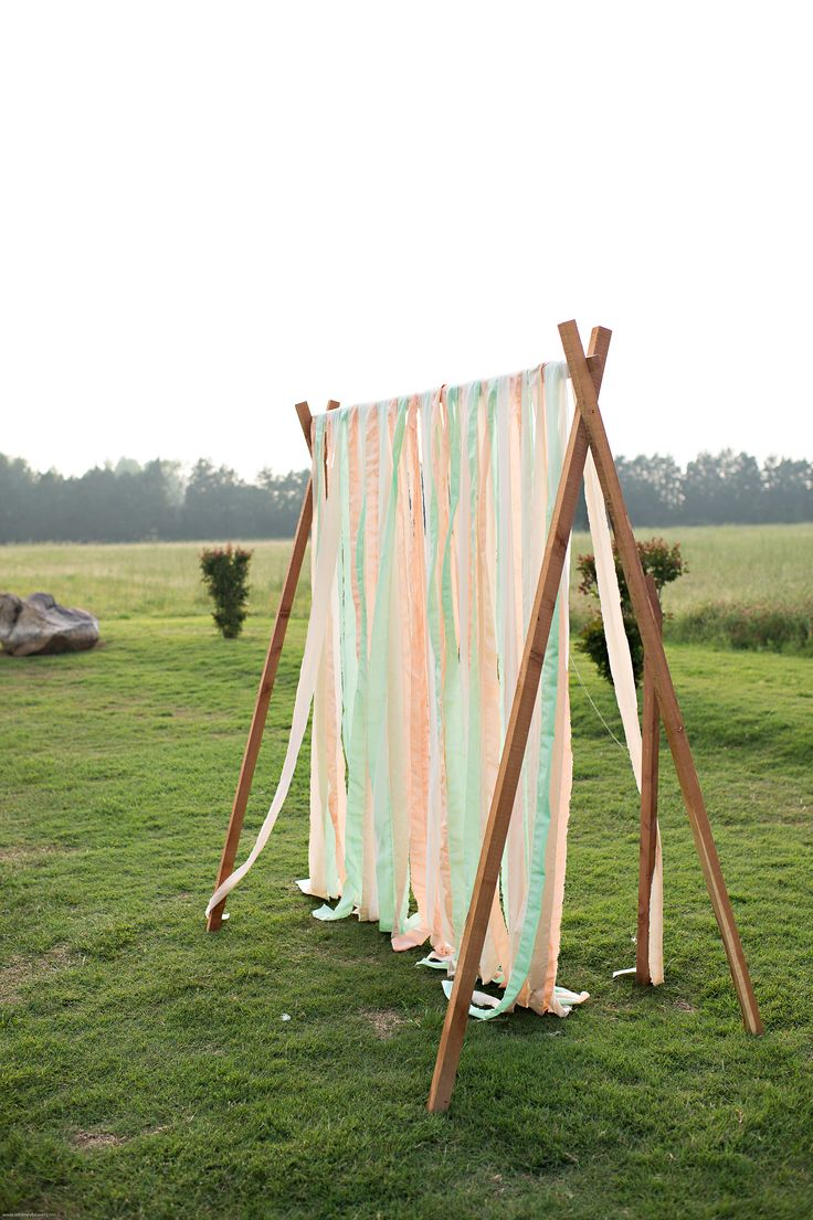 gorgeous backdrop my hubby made in our wedding colors: peach, mint, and cream
