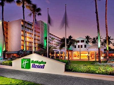 Holiday Inn Resort Aruba é um maravilhoso hotel em frente ao mar situado no impressionante destino Palm Beach. Com uma grande seleção de restaurantes, um belo espaço de praia e muitas atividades para todas as idades. Explore as instalações como o cassino Excelsior, o completo spa e aproveite todos seus serviços,  Há tanta coisa para fazer nas suas férias em Aruba que certamente ela será inesquecível!
