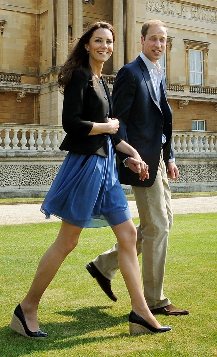 Kate Middleton. Love the flowing blue dress, but it would have to be below the knees for me to wear it. Love the black espadrille wedges!
