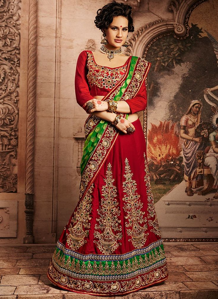 Shop this product from here.. http://www.silkmuseumsurat.in/red-applique-work-velvet-lehenga-choli?filter_name=4628  Item :#4628  Color : Red Fabric : Velvet Occasion : Bridal, Party, Reception, Wedding Style : A Line Lehenga Work : Applique, Embroidered, Patch Border, Resham