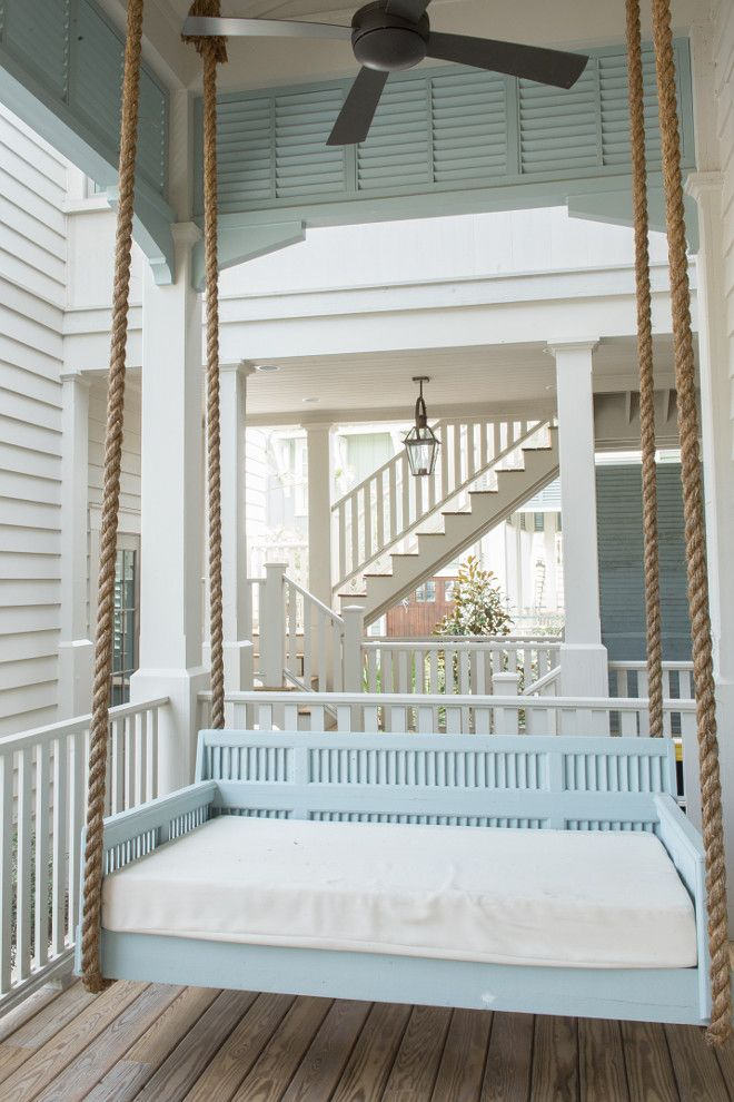 Beach House with Transitional Coastal Interiors Trim and Main Body Paint Colors: Benjamin Moore HC 172 Revere Pewter. Blue Shutters: Benjamin Moore AC 16 Kentucky Haze