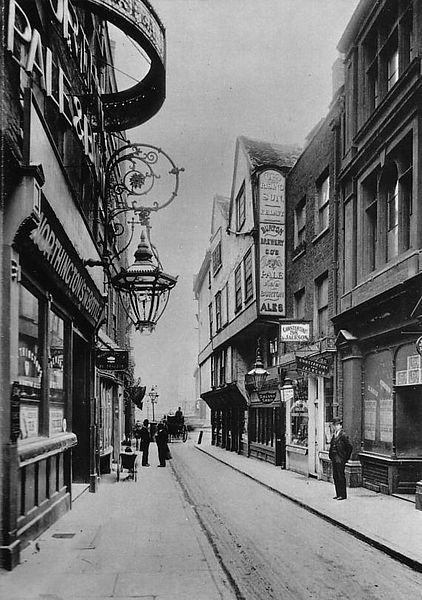 Wych Street, London (1901). Wych Street ran roughly where Australia House now stands on Aldwych, from the church of St Clement Danes on the Strand to a point towards the southern end of Drury Lane (>See Map). It was demolished by London City Council, c.1901, as part of the re-development that created Kingsway and Aldwych. What a fine, beautiful city street - why on earth did they destroy it? The usual depressing answer - progress ... Morons !! -- then as now !!