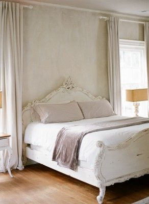 Serene and minimal modern vintage bedroom with antiques, quiet muted colors and touches of lavender in a timeless and tranquil mansion - Retreat at Cool Spring in Virginia.
