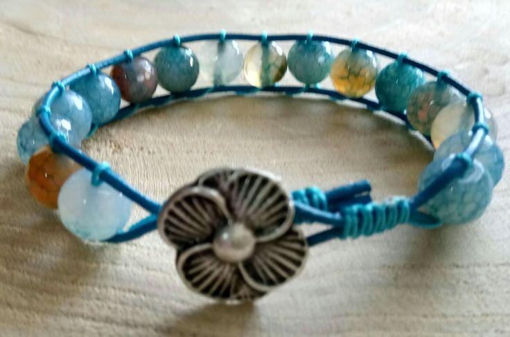 Beautiful Blue Wrapbracelet with flower lock