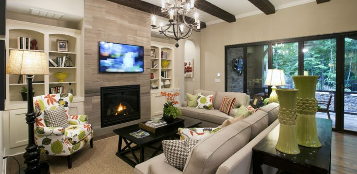 Leesville Crest - The Fairmont.   Living Room - open to the kitchen and doors open to outside water feature/pool/fountain.