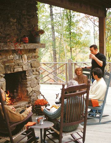 ooh cozy outdoor fireplace! Love the rocking chairs!