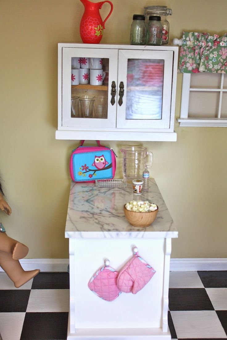 "pippaloo for dolls: The Dollhouse Tour: The Kitchen - a wall ""mounted"" cabinet and American Girl's Sweet Treats Bakery Case, from a few years back, which functions perfectly as a peninsula in the space."