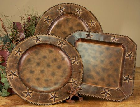 Set of 4 charger plates in a brown tone on tone antique finish with raised stars on the border are the perfect addition to your rustic dining room.  Use as a charger under your dinnerware or as serving platters.  They are wonderful decorative accents when not in use.  Place on stands in your china cabinet, on a shelf, top of your buffet or hang on the wall.  Add one of the many styles of dinnerware, faux leather placemats or table runners to complete your rustic dining table.