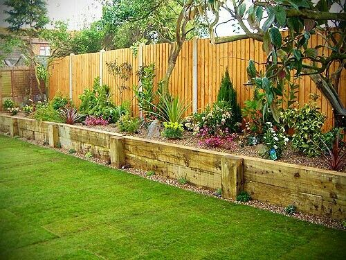 Raised planters along fence to add character and create barrier for dogs