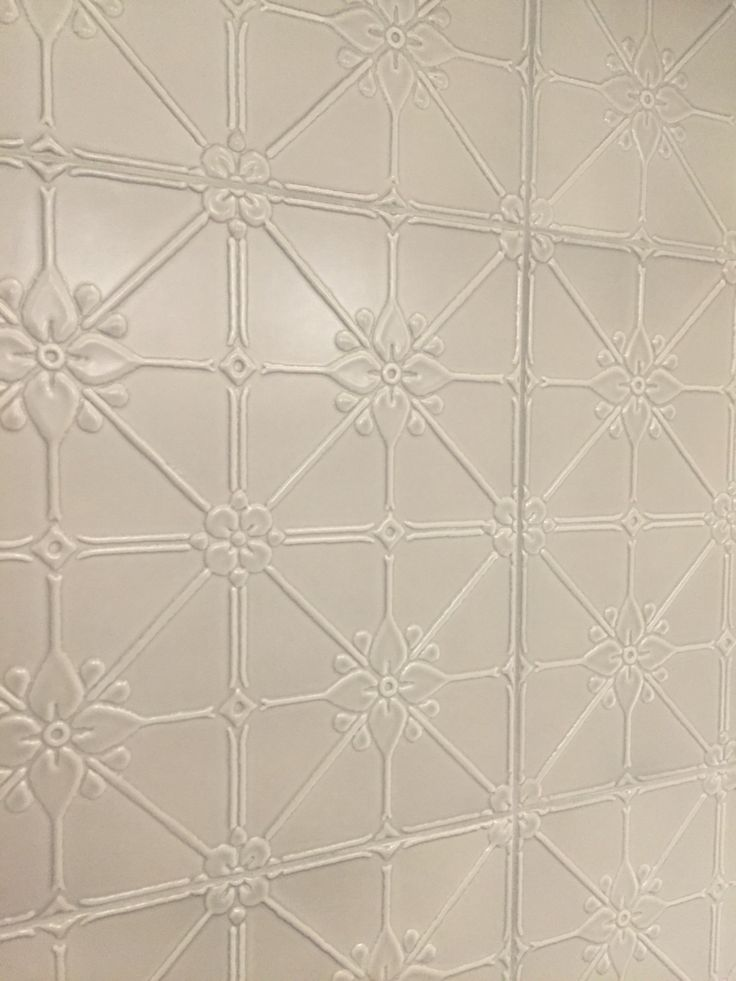 Photo 6: At first sight I thought this was pressed metal. Until I came up close and touched it and saw the grout I couldn't believe they were tiles. They looked stunning in the bathroom and brought a traditional feel to the space.
