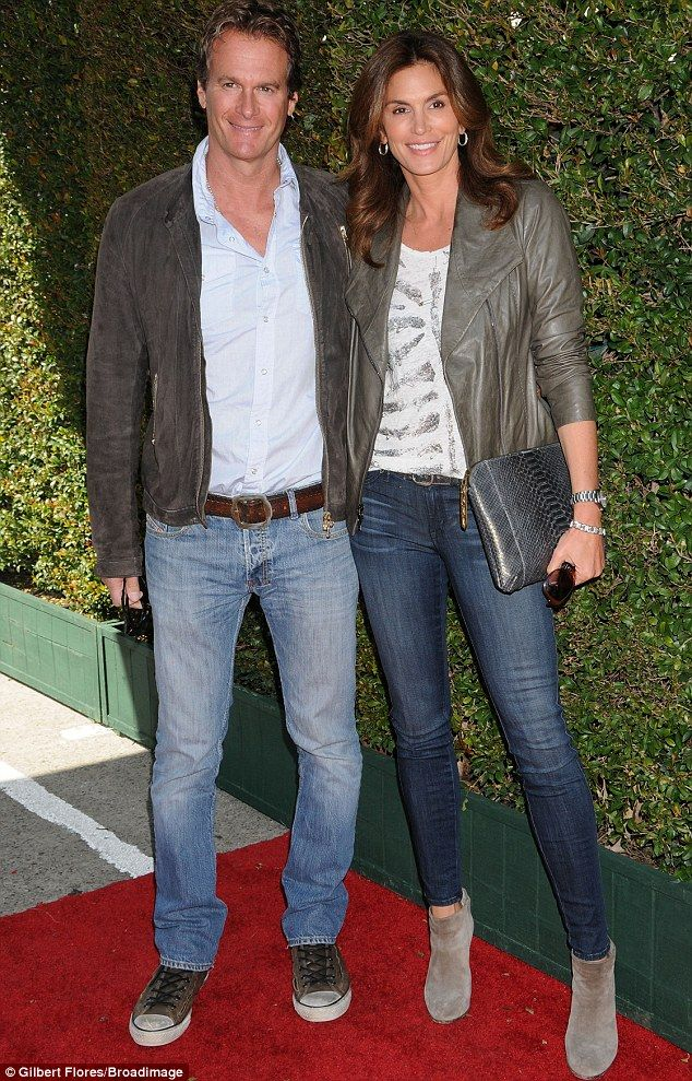 Handsome duo: Cindy Crawford cut a striking figure in jeans and leather jacket as she joined husband Rande Gerger at the John Varvatos Stuart House Benefit in Los Angeles on Sunday