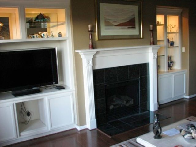 Lastest  Television Mounted Over The Fireplace Builtin Bookcase Next To The