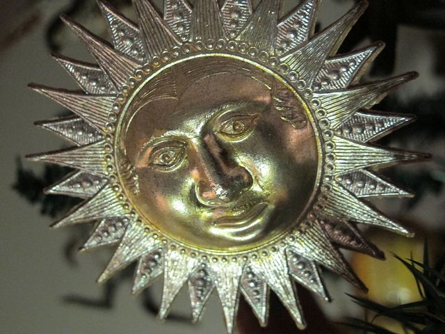 A Cleveland Antique Christmas Collection by Whopperjaw, via Flickr...Dresden sun face from Darla & Jerry Arnold