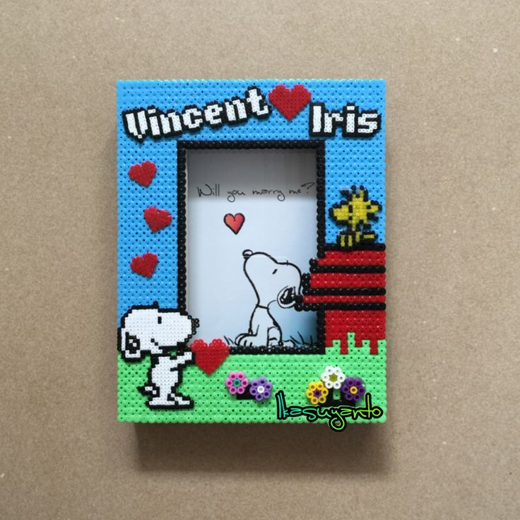 Special Snoopy photo frame with a 'room' between the picture and the glass cover to put the inside. Cheers for Vincent and Iris