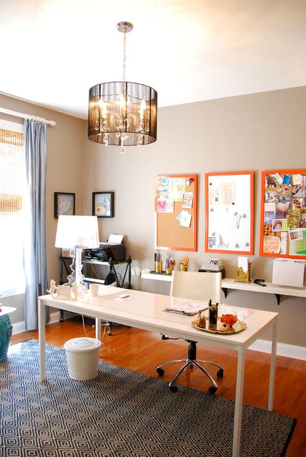 Office, white desk, white shelf behind, orange cork boards, chandelier - love.