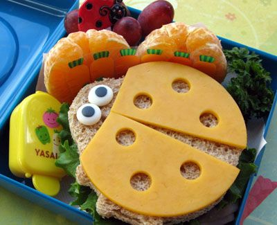 easy ham and cheese sandwich and transformed it into this lovely little ladybug by simply using a cookie cutter, cheddar cheese on top and buggy icing eyes. Also included on this lunch menu are mandarin oranges and seedless grapes