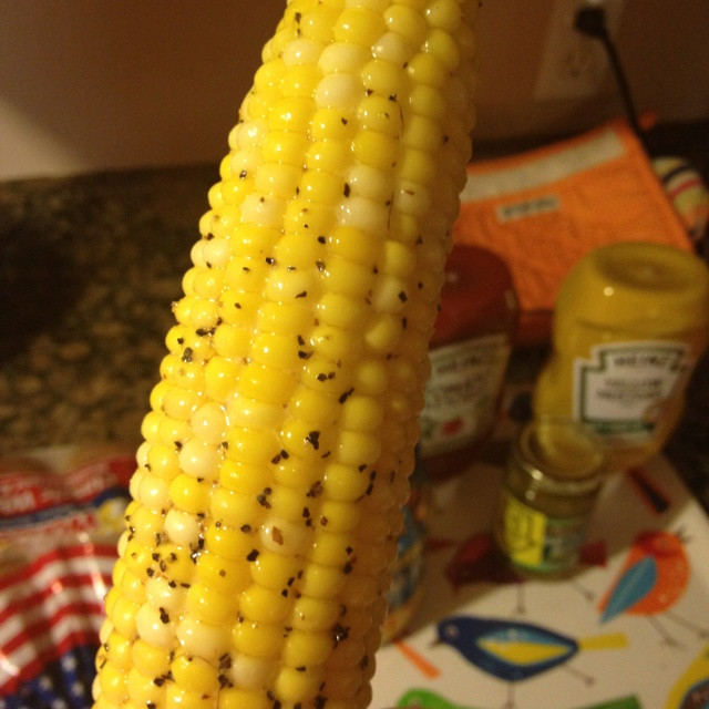 YUMM!! Easy corn on the cob that tastes AMAZING!! Heat the oven to 350. Throw the corn with husk on into the oven. I tossed it into a glass baking container but it would work in something else or even just laid upon the oven rack. Bake for 30-35 minutes. Remove and de-husk. Then I rolled it in butter, salt, and pepper. AWESOME!!!!! :)