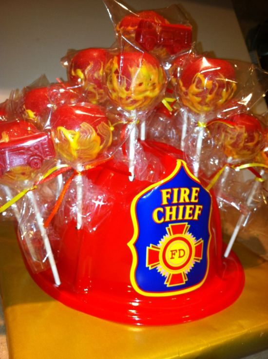 Fire Fighter Cake Pops - like using the helmet to hold 'em