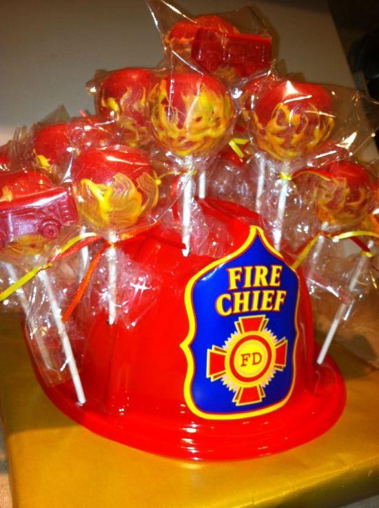 Fire Fighter Cake Pops - like using the helmet to hold 'em