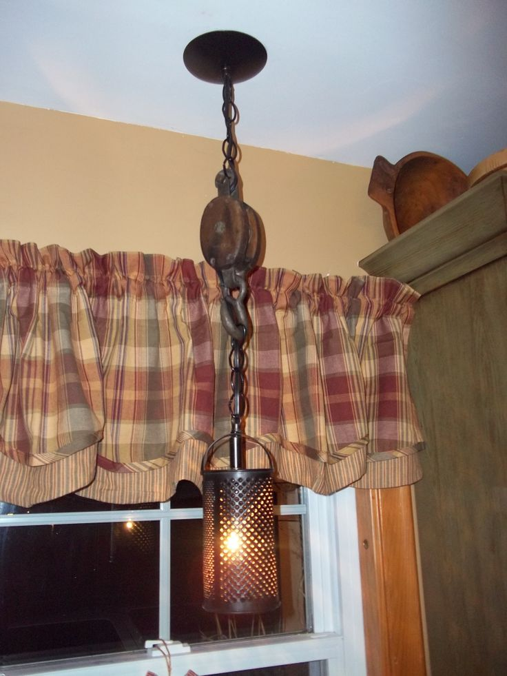 Primitive Re-Purposed lighting made from an old wooden pulley and food grater. Darrell's Refinished & Recycled Antiques and Primitives https://www.facebook.com/groups/331221526959691/