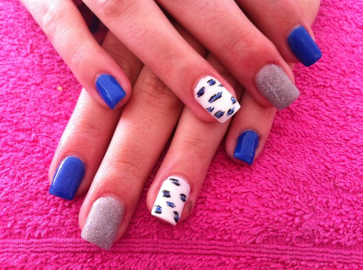 Blue leopard nail art. Done by Designer nails George