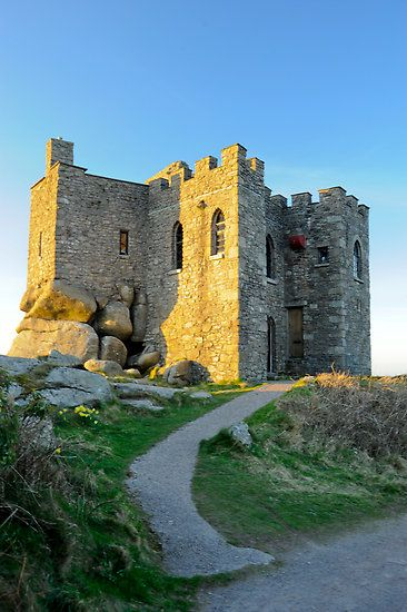 Carn Brea Castle - Redruth, Cornwall, England;  this was originally built as a chapel, in 1379, before being rebuilt in the 18th century by the Basset family as a hunting lodge;  it is considered a FOLLY castle, due to the huge uncut boulders that make up part of its foundations, giving the impression of the building melting into the land;  photo by DonDavisUK