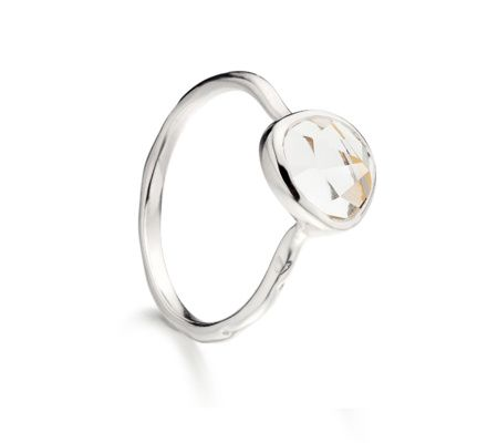 This product is available online only. Perfect for stacking, this delicate ring features an organic, irregular shaped multifaceted White Topaz gemstone, set in Sterling Silver. The band has a slightly waved edge, reminiscent of the sea. The stone on this ring measures approximately 8mm x 7mm. The band measures approximately 1.5mm thick at widest point.
