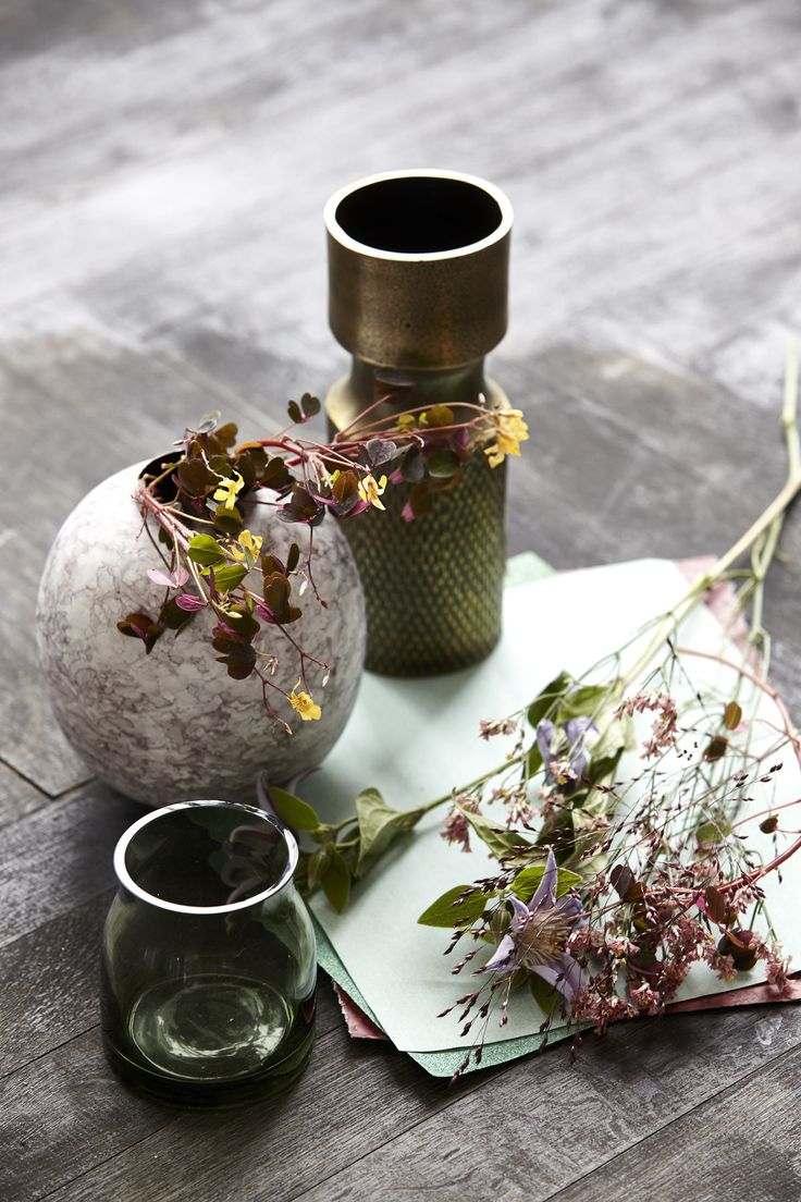 To create a sophisticated and simple look, snip off a few stems of delicate blooms and display them in a spare setting, like against a bare wall or in a window ledge. Use small vases in mixed heights and materials to create a pleasing composition.