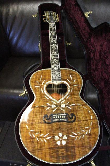 2007 Vine Custom Gibson SJ200, one of only three made. I'll take one thank u! What? It's my birthday please!