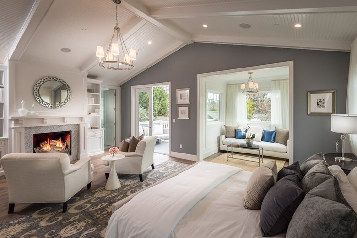 Traditional Master Bedroom with Hardwood floors, Built-in bookshelf, Carpet, Pendant Light, Crown molding, stone fireplace