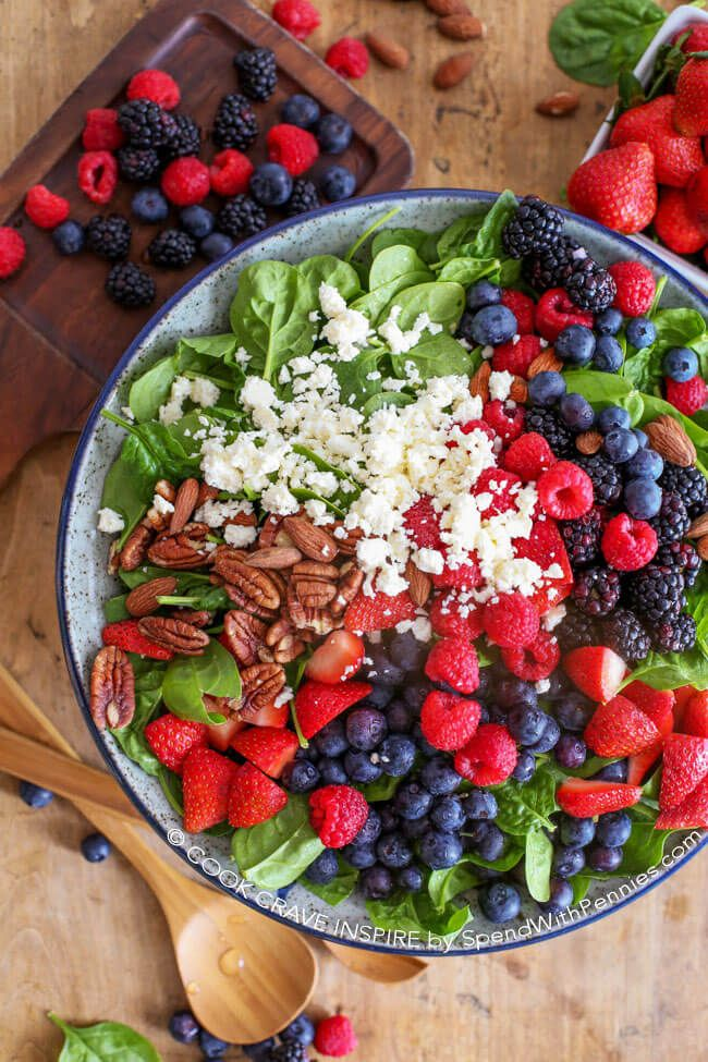 This delicious spinach salad recipe is loaded with our favorites; strawberries, blueberries, raspberries, feta cheese & toasted nuts for the perfect salad!