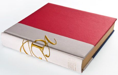 Hardcover book embellished with embroidery on the back.