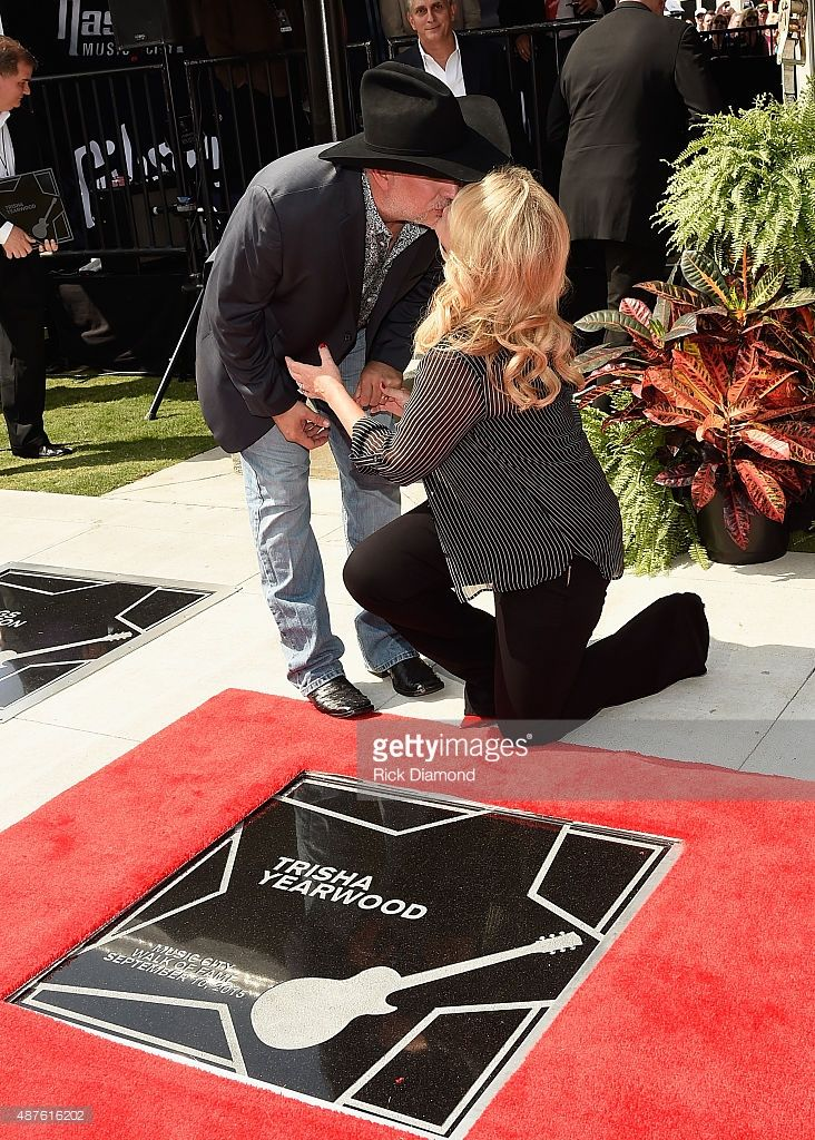 Garth Brooks and Trisha Yearwood are Inducted Into The Nashville Walk Of Fame. (pictured) Husband and Wife Honorees Garth Brooks joins Trisha Yearwood on her Star at the Nashville Music City Walk of Fame on September 10, 2015 in Nashville, Tennessee.