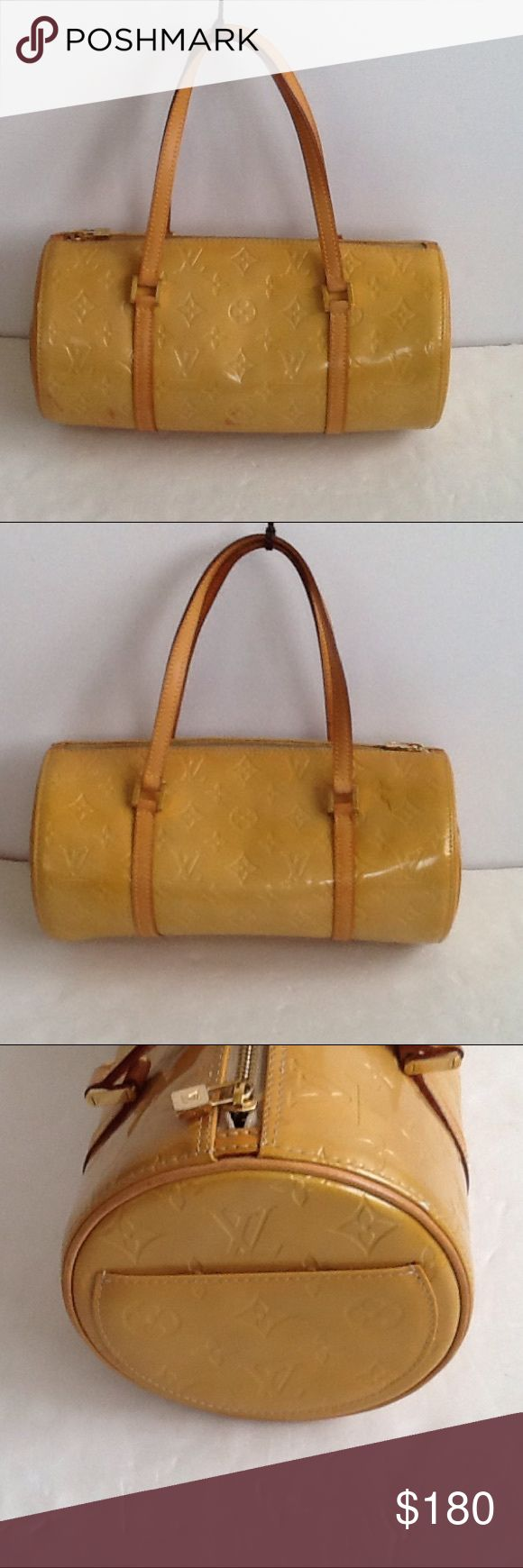 Authentic Louis Vuitton Bedford Gold Vernis Bag. The canvas had some stains. The inside linen had done peeling in the top. The bag was made in France with a date code VI 0959. The straps are good condition, the dimension us 12 and 5.5. The color is between good and yellow. Louis Vuitton Bags Satchels