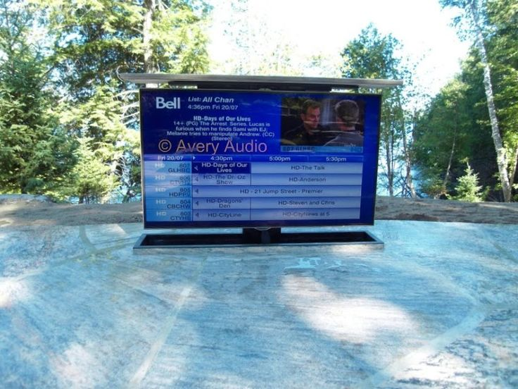 Outdoor Hot Tub Home Theatre complete with URC RF remote controlled motorized TV lift.  TV retracts below stone when not in use.