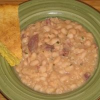 Nothing-to-It Slow Cooker Ham and Beans  1lb Great Northern or similar dried bean 1 lg sweet onion, chopped  1 meaty ham bone 3 c stock(pork, chicken, veggie, or any combo)  3 c water fresh ground pepper