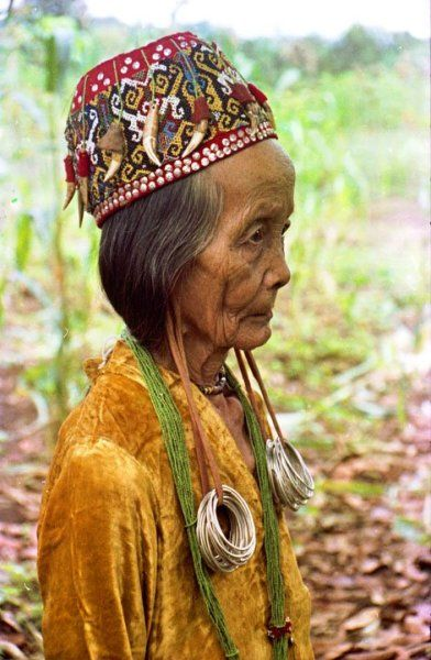 Indonesia | Old woman from Dayak Kenyah tribe, East Kalimantan. | Women with long earlobes in Dayak Kenyah tribe are considered noble and respectable, while nowadays the tradition is no longer common among the tribeswomen.