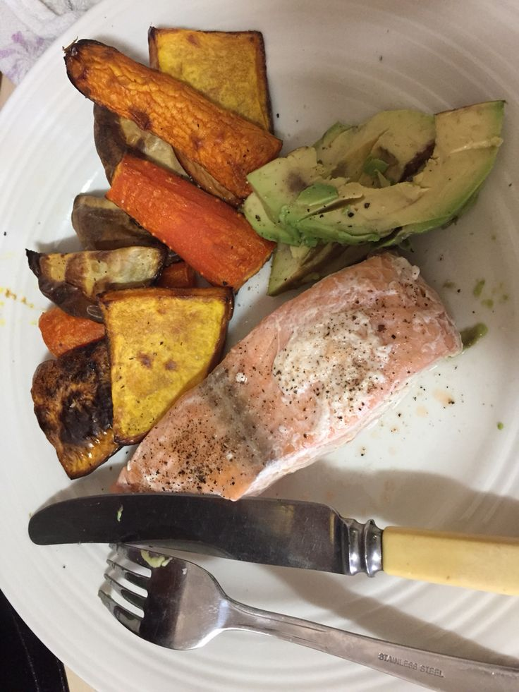 Poached salmon with roast vegetables and avocado