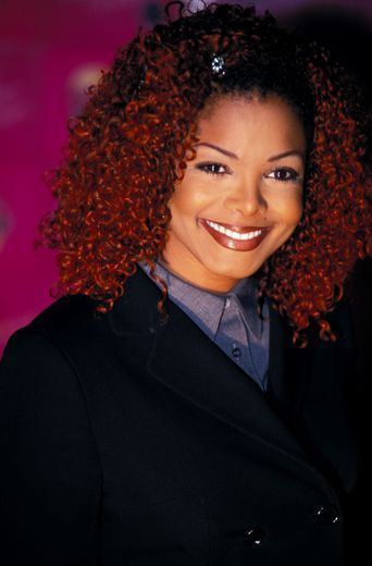 2001:  Red Alert - See Janet Jackson's Best Hairstyles in Honor of her 50th Birthday!