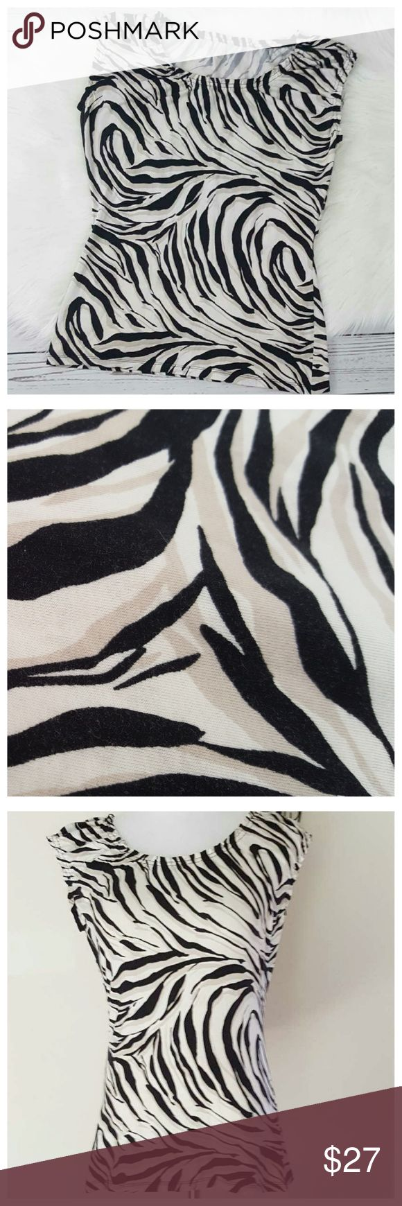 LOFT Zebra Print Cap Sleeve Top MD Cotton Blend Ann Taylor LOFT Zebra Animal Print Top. Lightweight, stretchy soft tee. Scoop, elastic neckline with cap, elastic short sleeves. Colors: White, black and cream. Women's size medium. Flat lay measurements shown in pic 4. 95% cotton, 5% spandex. Machine wash cold. Overall very good condition, minimal wear from wash/wear twice. LOFT Tops Tees - Short Sleeve