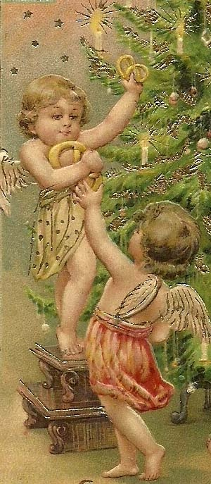 Two cherubs decorate a Christmas tree with pretzels.