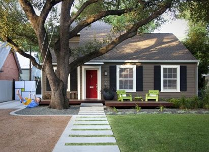 The white trim with the contrasted paint and shutters pop almost as much as the red door - cute idea for small house!