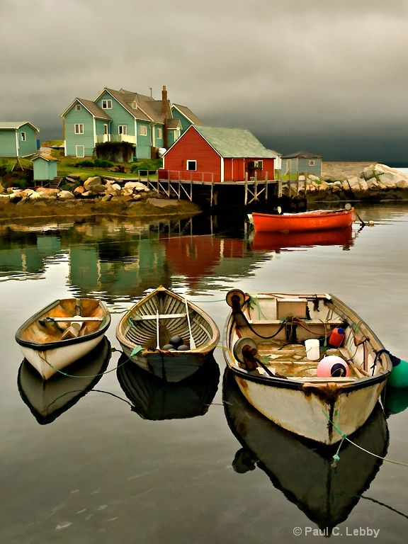 Description: Peggy's Cove, Nova Scotia. The middle boat is over 50-years-old; I met the owner with a buddy of mine, John Barclay, who shot these boats eight years ago. The boat owner/fisherman recognized John and remembered him taking pictures of the same boats eight-years ago. Nothing changes in these little lobster fishing coves.
