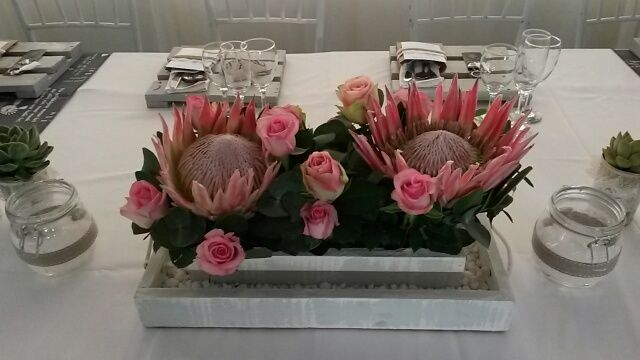 Pink King Protea table decor at Oak House wedding venue