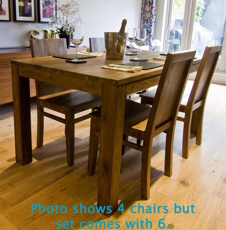 The 'Setangi' Dining Set – a beautiful and unique, solid wood table made from reclaimed teak and six wooden chairs.